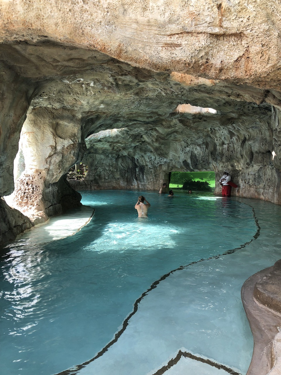 Grotto with aquarium view of nurse sharks and rays