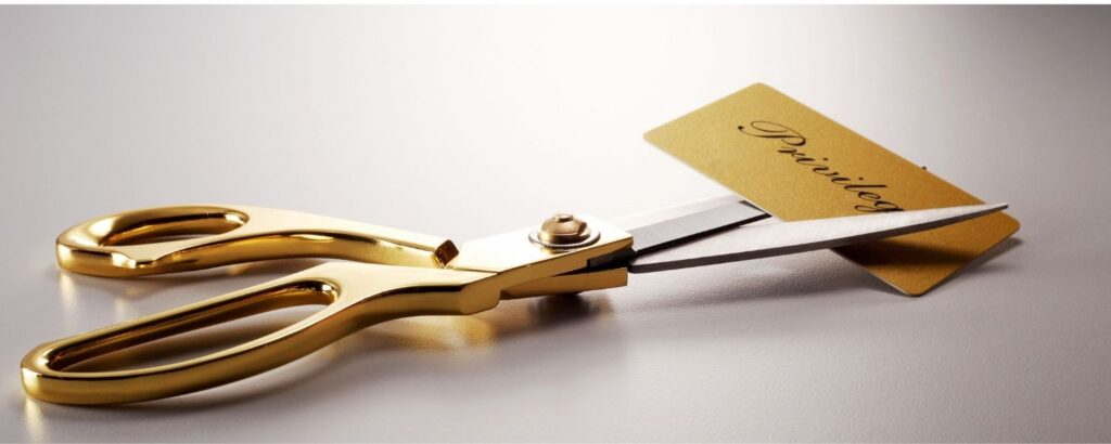 Golden Scissors Cutting Golden Credit Card