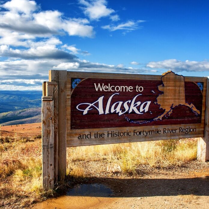 Welcome to Alaska sign for best budget hotels in alaska article